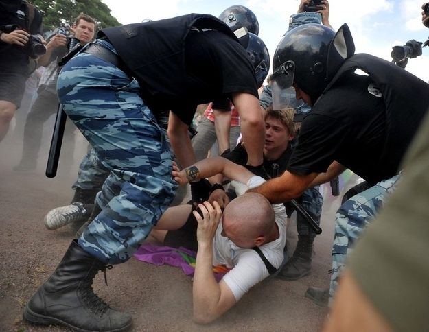 'A gay rights supporter is beaten to the ground' in Russia. Credit: Olga Maltseva, Getty Images via Buzzfeed.