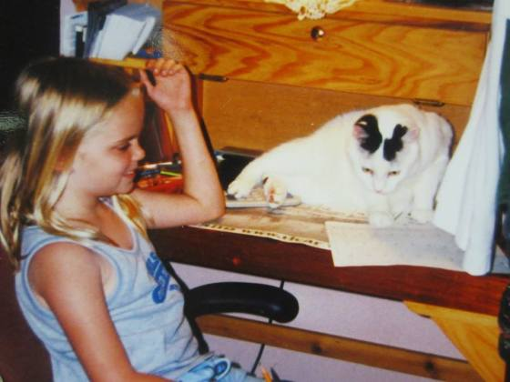 Scruffy helping Kristin (here, aged 9) with her homework. Or, sorta' helping with her homework.
