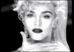 "Madonna in her video for ""Vogue."""